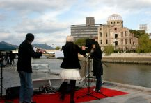 Flautists play across the river from the A-Bomb dome