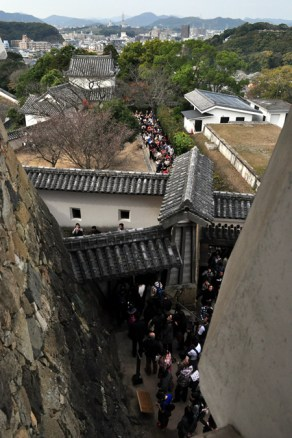 View from castle lower floor - packed with people queuing to enter