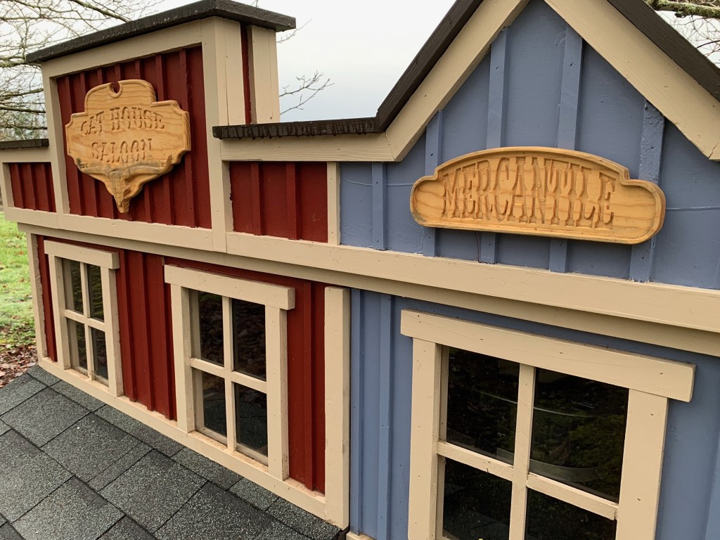 Closeup on cat house signs