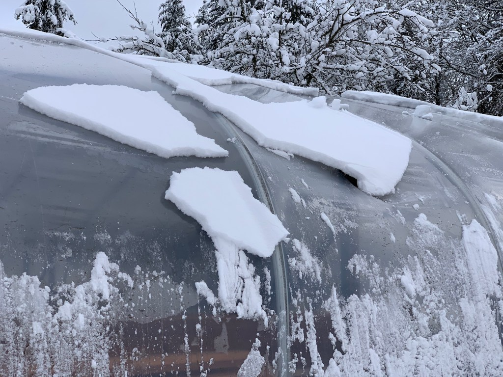 Snow sliding off hoop house