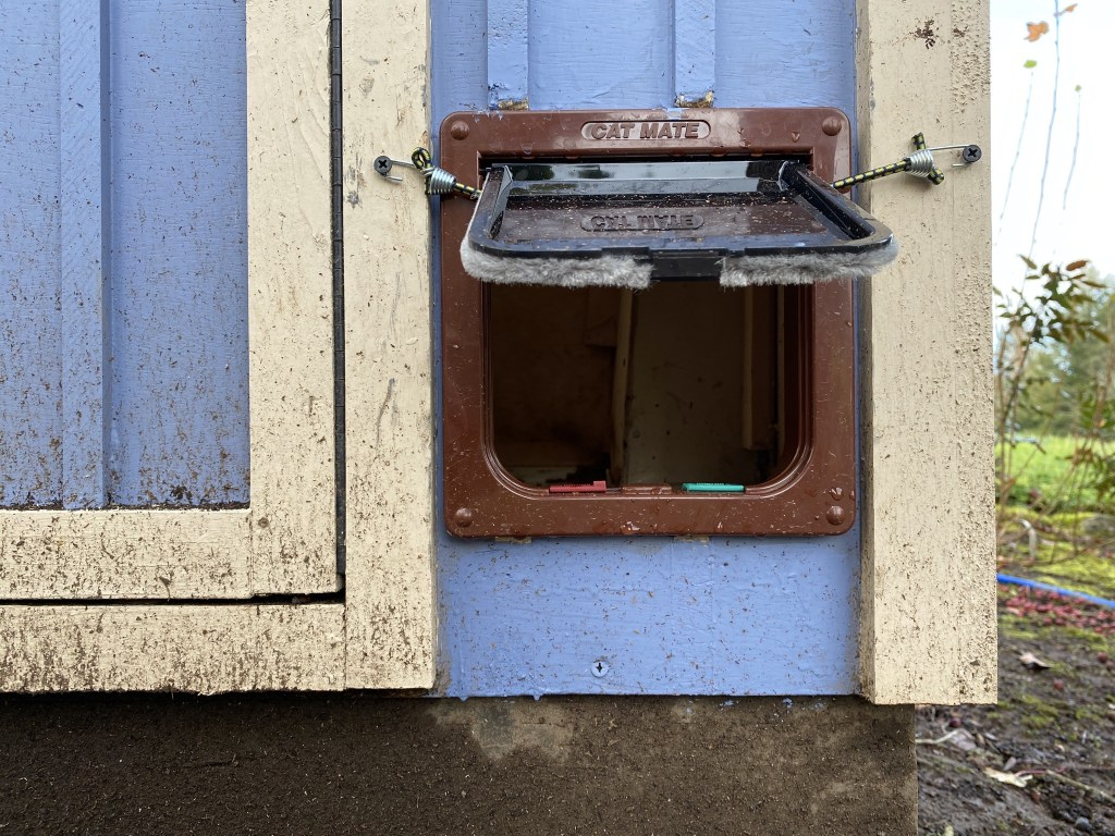 Feeder door held open