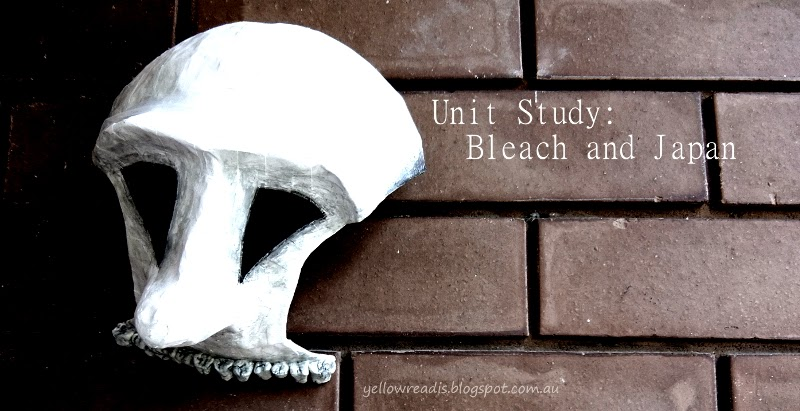 Unit Study: Bleach and Japan Image: White Hollow mask on bricks