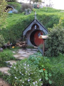 Hobbit Hole in Hobbiton. Small red door in green hillside
