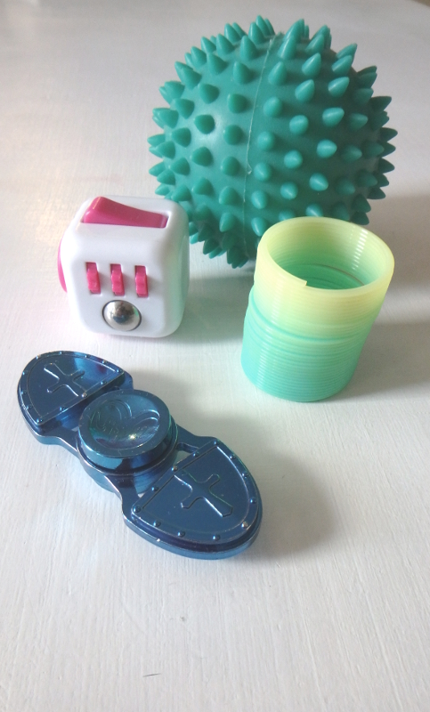 Yellow Readis is Back and Writing! | yellowreadis.com Image: Collection of 4 fidget toys.