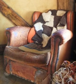 Archive, yellowreadis.com Image: Old chair with blanket in room