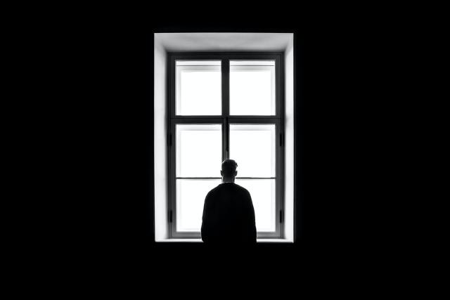 person looking out of window