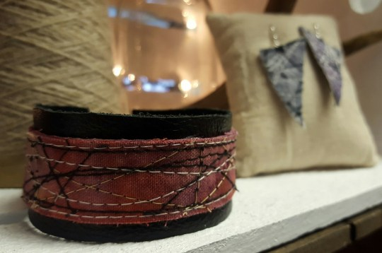 Naturally dyed and machine embroidered bracelet with leather