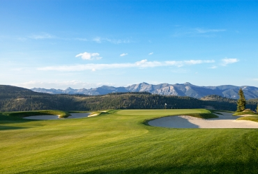 The Rocky Mountains serve as a beautiful backdrop on the 3rd hole.