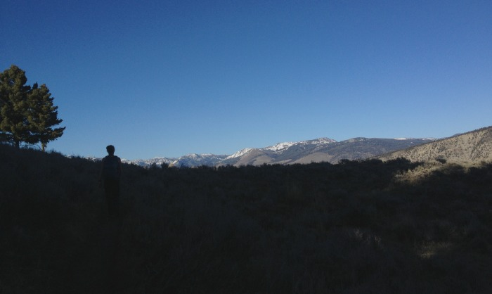 boy in shadow in mountains