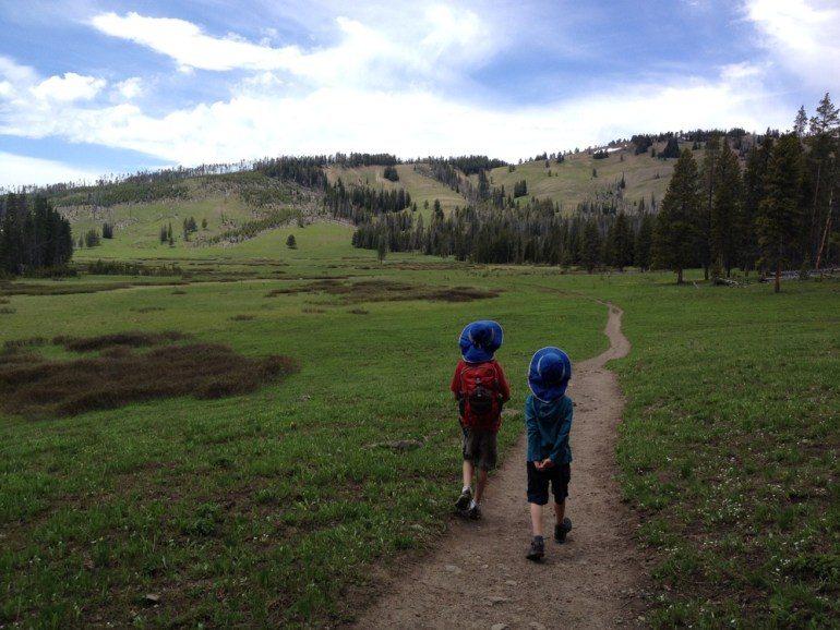 boys hiking on trail