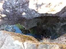 Which plunges deep below the gap in the rocks