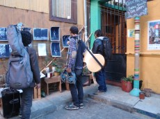 A group of musicians trying to find the location of their gig that night are temporarily distracted by an informal photography display