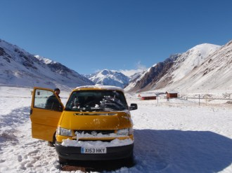 Looking back at the dramatic peak of Aconcagua behind us above the pass
