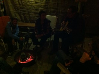 A sociable evening around the fire with their hosts