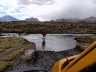 Next mission - to find the hot springs. Bruce checks the depth of a water crossing