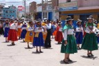 Beautiful colourful costumes fill the rather scruffy streets leading to the square