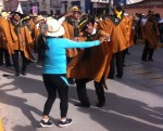 A passerby pulled into the parade for a dance