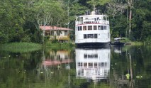 On our way back to Iquitos, moored at the entrance to the park to complete exit formalities