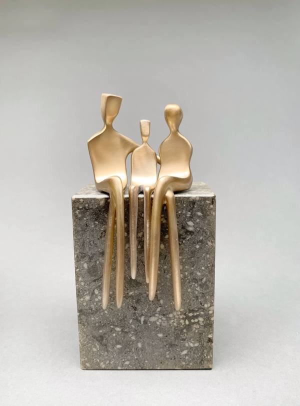 family of three in brushed bronze