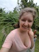 Intern Erin Sullivan picking fevergrass for distillation