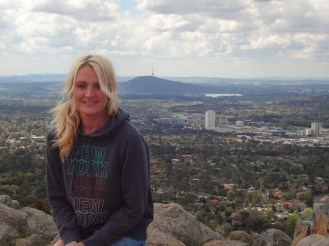 Kerry at the top of Mt. Taylor with Woden in the background