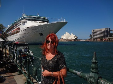 Gail with a cruise liner and The Oprea House behind her.
