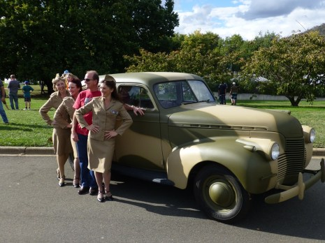 The Andrew's sisters with a World II Staff car.
