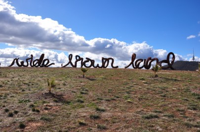 I think it says 'wide brown land' !!!