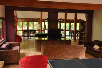 The lounge behind reception at Ferntree Rainforest Lodge