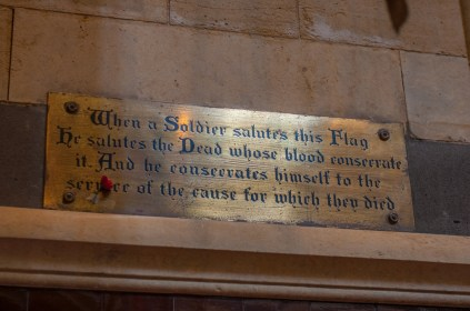 Plaque describing an old battle honour flag inside the cathedral.