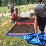 Youth building raised bed gardens at Beecher Middle School in Flint, MI.