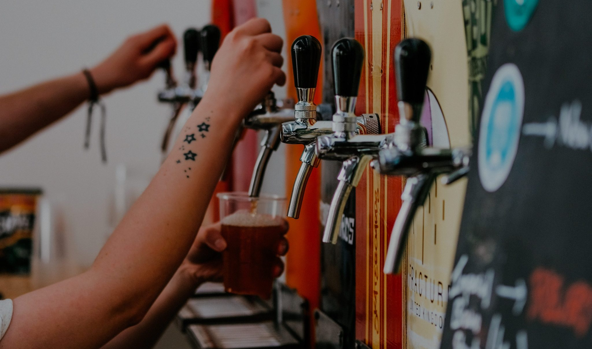 craft lager beer taps in pub made from skateboards