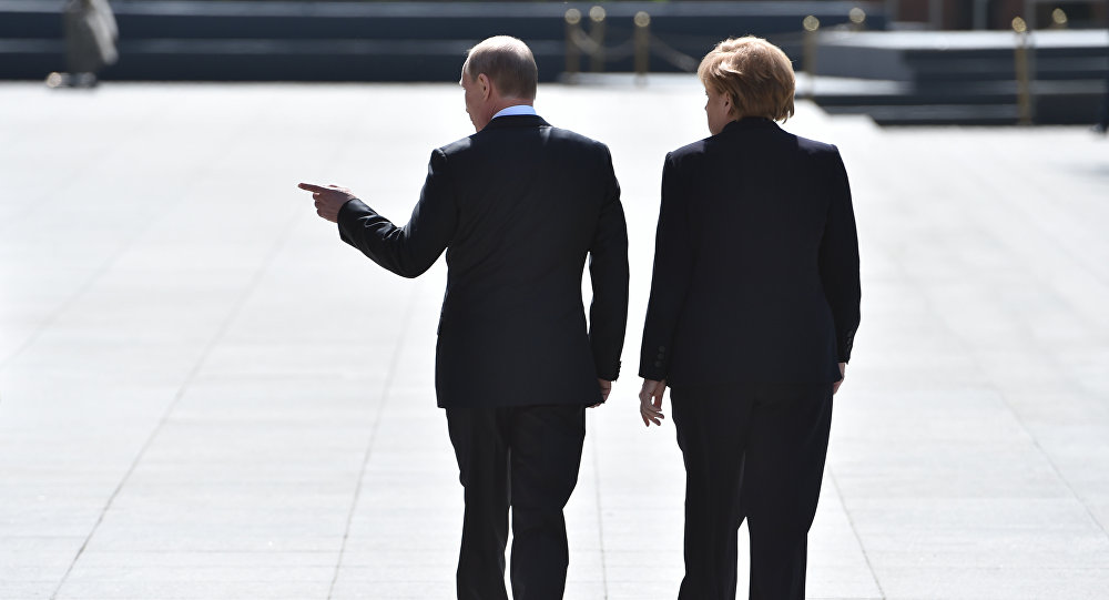 Putin and MerkelHow Merkel's Meeting With Putin Fits Into 'Germany's Foreign Policy Ambitions'