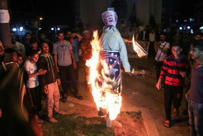 IN PICTURES: Palestinians in Gaza burn effigies of Trump, stomp on American and Israeli flags
