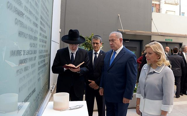 At sites of bombings, PM vows Israel will relentlessly confront Iranian terror
