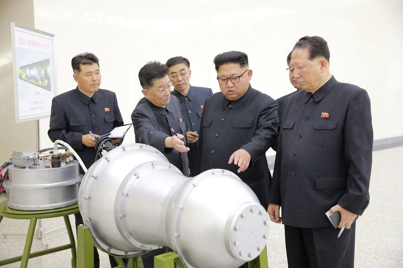 Kim Jong-un 'inspects NUCLEAR BOMB which could be loaded on long-range missile launcher' in terrifying new North Korea development
