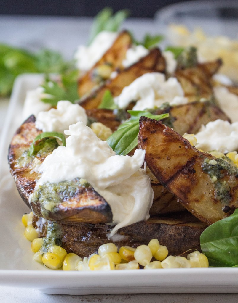 Grilled Garlic-Herb Potato Wedges with Corn, Pesto, & Burrata