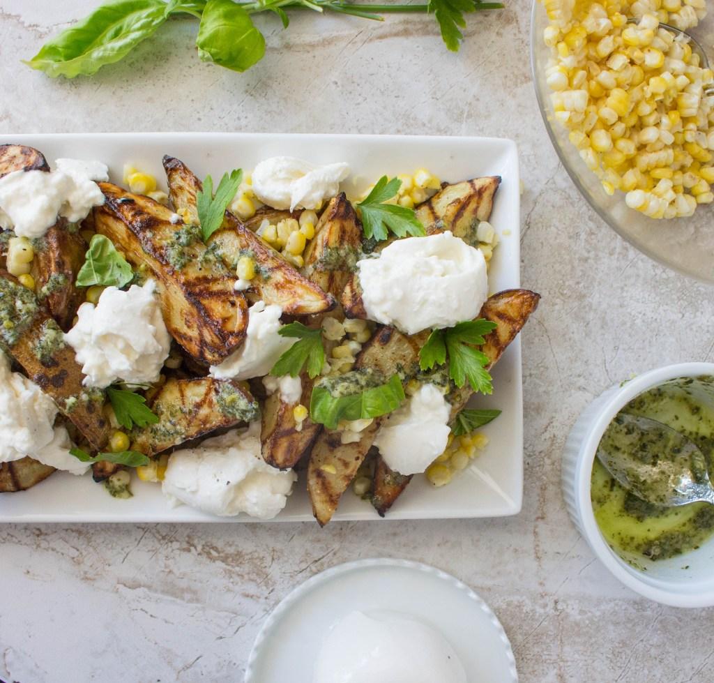 Grilled Garlic-Herb Potato Wedges with Corn, Pesto, & Burrata