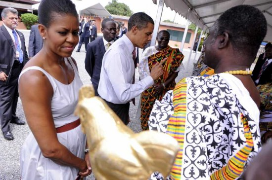 BLACK SKINNED BEAUTY FIRST LADY MICHELLE OBAMA AND OUR BLACK PRESIDENT OF THE BLACK WORLD GREET TRADITIONAL DOCTORS(BENI,TRADITIONAL HEALERS!) AT THE LA GENERAL HOSPITAL,ACCRA,JULY 11,2009