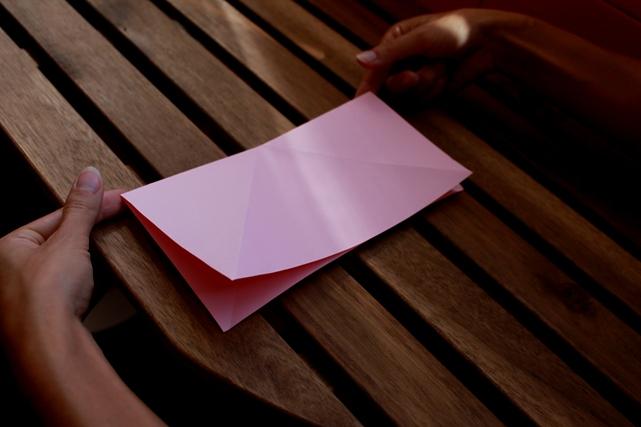 doblar papel por la mitad