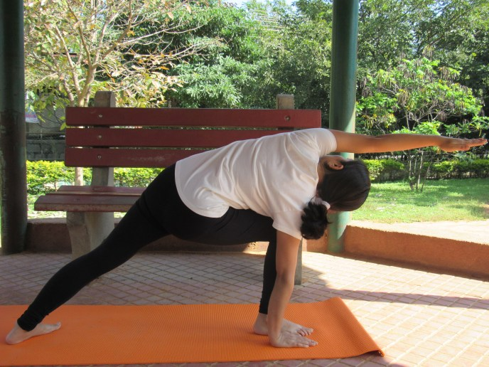 Yoga pose:Extended Side Angle Pose from backside