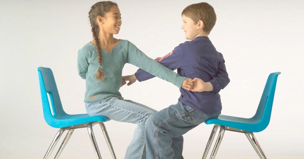 Children Doing Partner Pose While Sitting