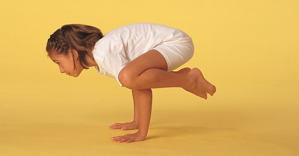 child in crow pose