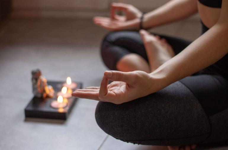 Doing Sukhasana Yoga pose