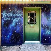 Front door of Jentilly Ln. Studio - with new mural that looks like a milky-way ridden nigh sky. With the green door in the middle.