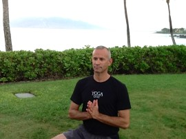 Joe Caperna giving thanks to Hawaii in Easy Pose