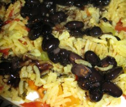 black bean sauce over rice and vegetables
