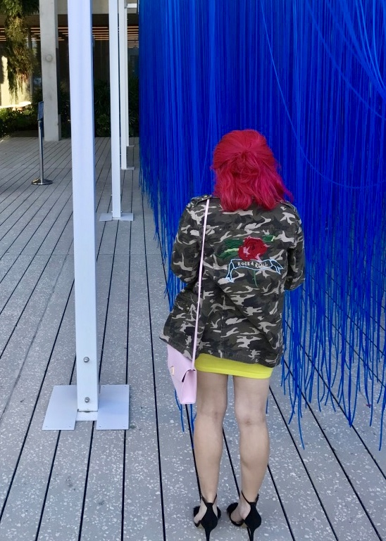 Girl with bright pink hair