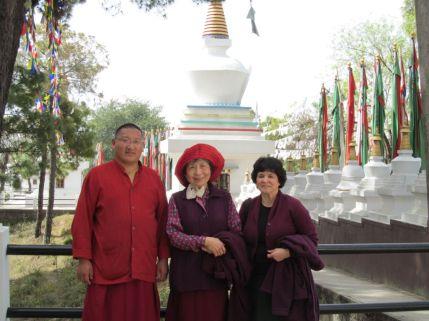5_Chenme Khenpo Gyurme_Dorje Palmo_Patricia Viewing Stupas_Prayer Flags
