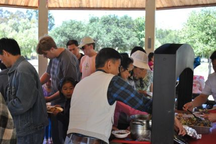 Busy_Crowd_at_the_Serving_Tables